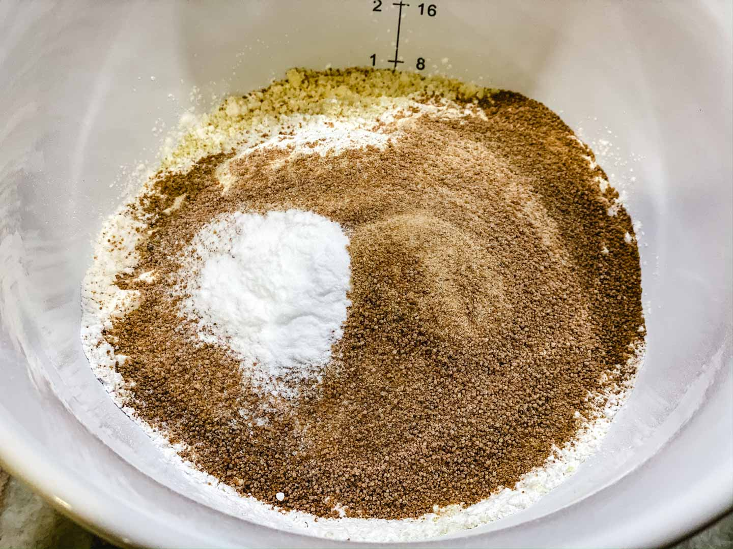 Baking flours, coconut sugar in a white bowl.