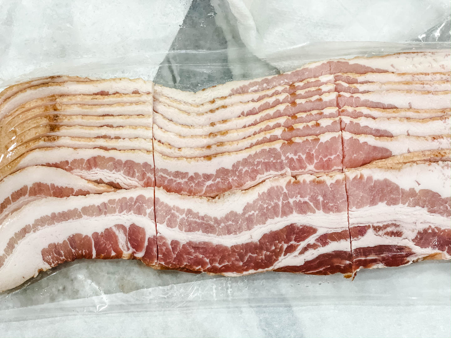 Sliced raw bacon