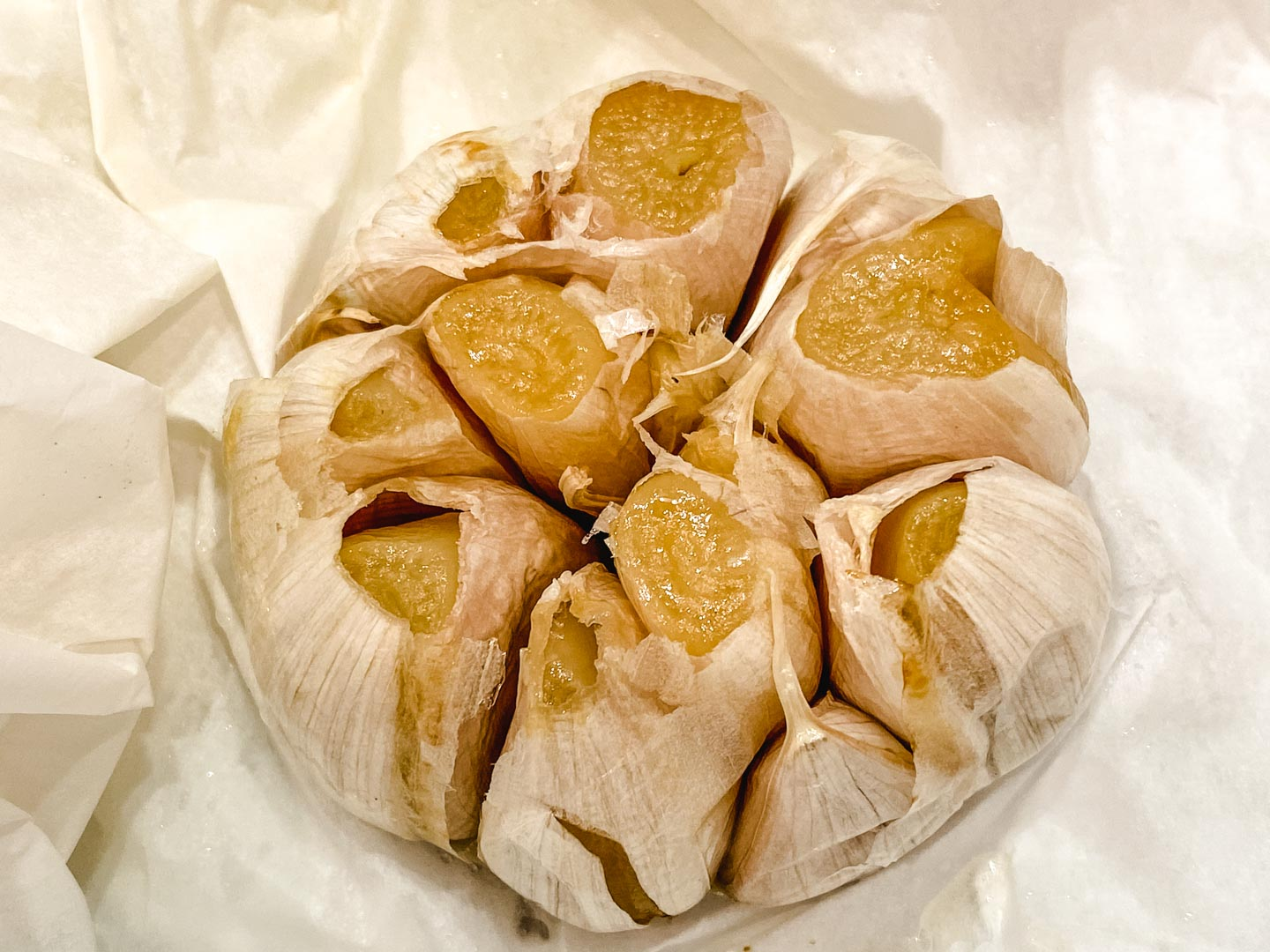 Roasted garlic on parchment paper.