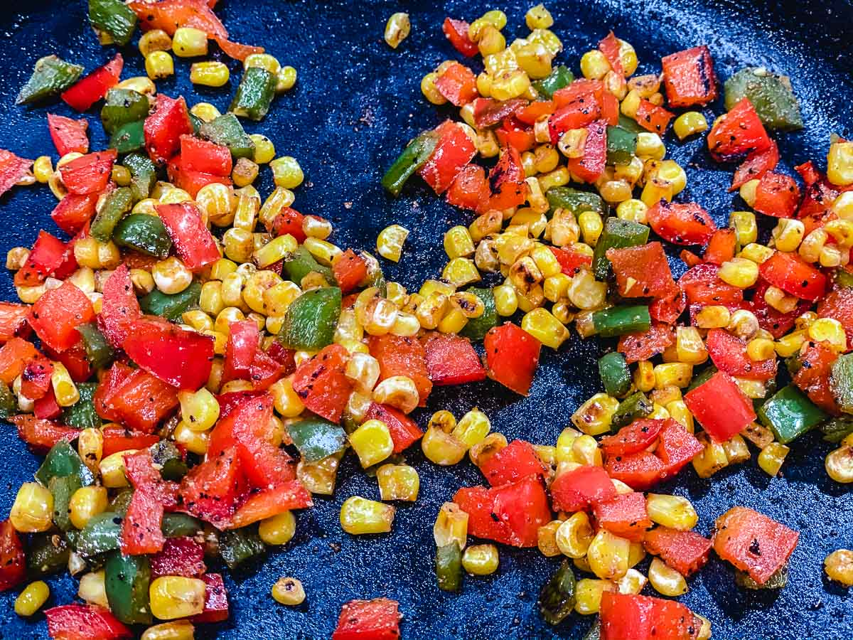 Corn and peppers in a cast iron skillet