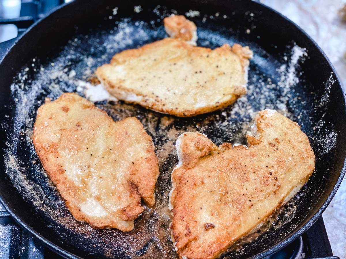 Cooked chicken in a frying pan.