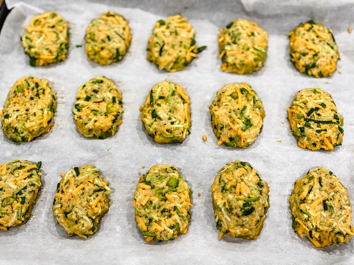 Zucchini, cheese, egg, almond flour, cheese, spring onions, salt, pepper, and smoked paprika shaped into bite size pieces.