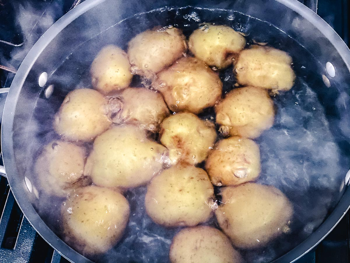 Potatoes boiling in water.