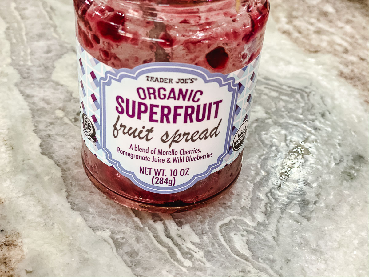 An empty jar of organic super fruit spread.