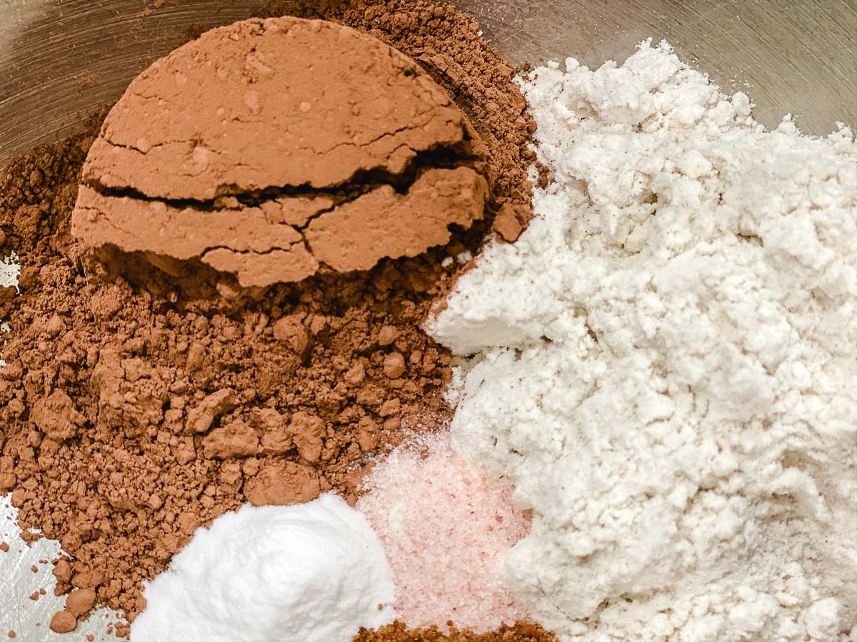 Cacao, gluten free 1:1 ratio flour, salt, and baking soda in a bowl.