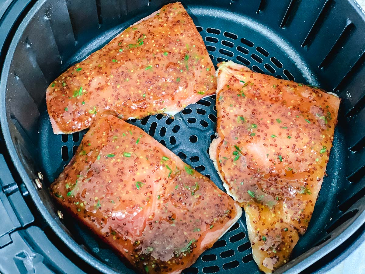 Salmon pieces in the air fryers.